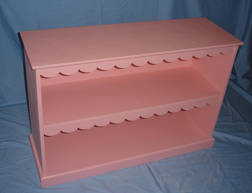 Kids toy cabinet with one shelf fully covering in pink paint finish